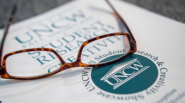 glasses resting on UNCW Student research document