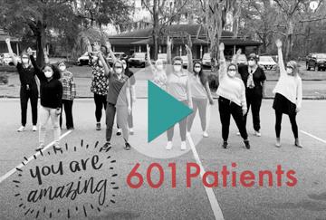 nursing staff celebrating serving 601 patients, link to video