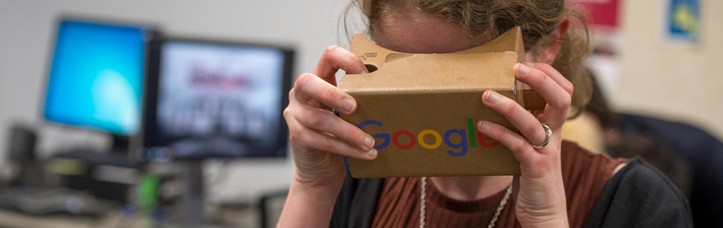 Woman using Google-branded VR headset