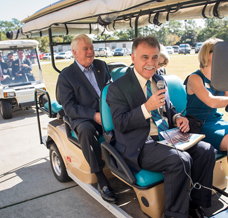Chancellor in golf cart
