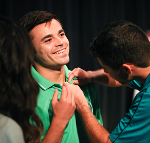 Father pins son at Legacy Pinning Ceremony