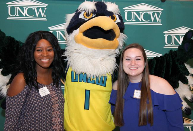 Taniesha Young with Sammy C. Hawk and UNCW colleague